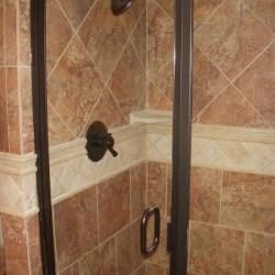 custom tiled shower, glass shower doors