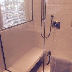 Shower with custom seat, ceramic tile and glass doors