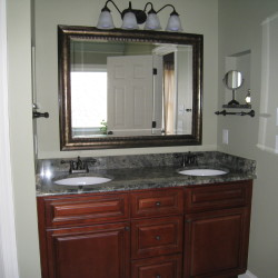 Bathroom remodel with new cabinets, fixtures and granite countertop