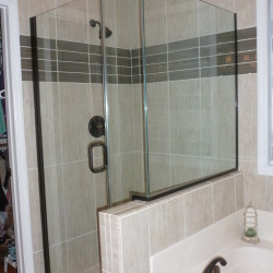 Large Shower with class doors and ceramic tile