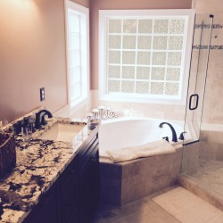 Beautiful custom bathroom with ceramic tile and granite counter tops