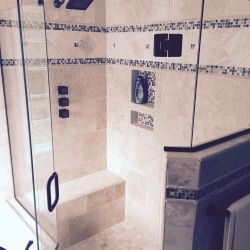 Large walk in shower with custom seat and nice
