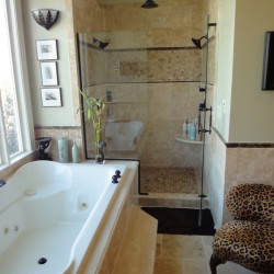 Bathroom remodel, step up Jacuzzi tub, glass shower doors, dual shower heads