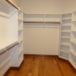 Large custom closet with handing areas and shelves