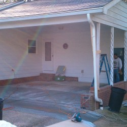 carport converted to a custom 2 car garage before picture