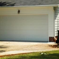 carport converted to a custom garage after picture