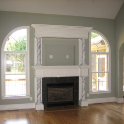Family Room with arch windows and custom fireplace