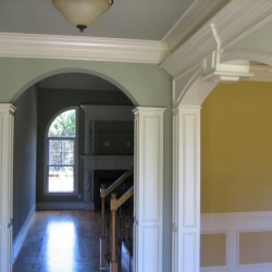 Foyer with arches and detailed trim work
