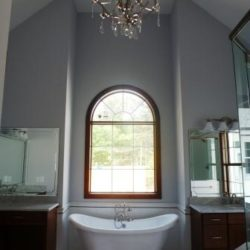 Large custom bathroom with vaulted ceiling