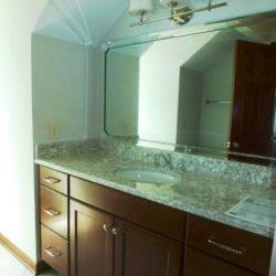 Guest bathroom vanity in bonus room