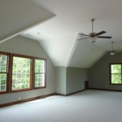 Large bonus room with ceiling fan and lots of winders