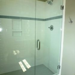 Large glass shower with custom tile work