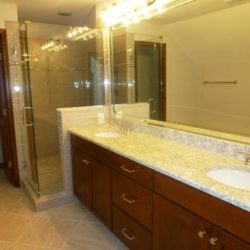 Guest bathroom with large vanity and glass shower