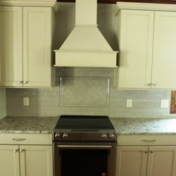 Custom cabinets with stove and hood