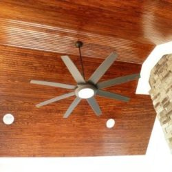 Bead board ceiling wtih large ceiling fan in screened in pourch