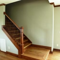 Stair case with custom wooden railing